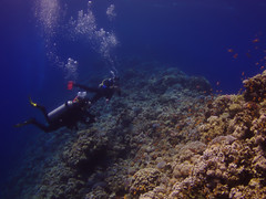 Crossing the Saddle into the Blue Hole