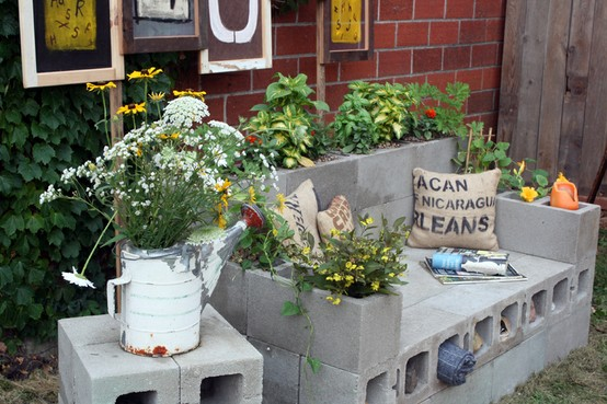 Garden Ideas Using Concrete Blocks - Multipurpose garden bench that provides seating, planting space and storage. Excellent for small spaces.
