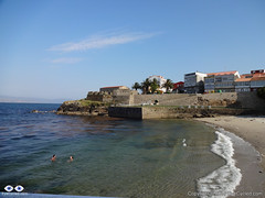 "Small beach in the town of Fisterra. San Carlos castle at the, today a ""fishing museum""."