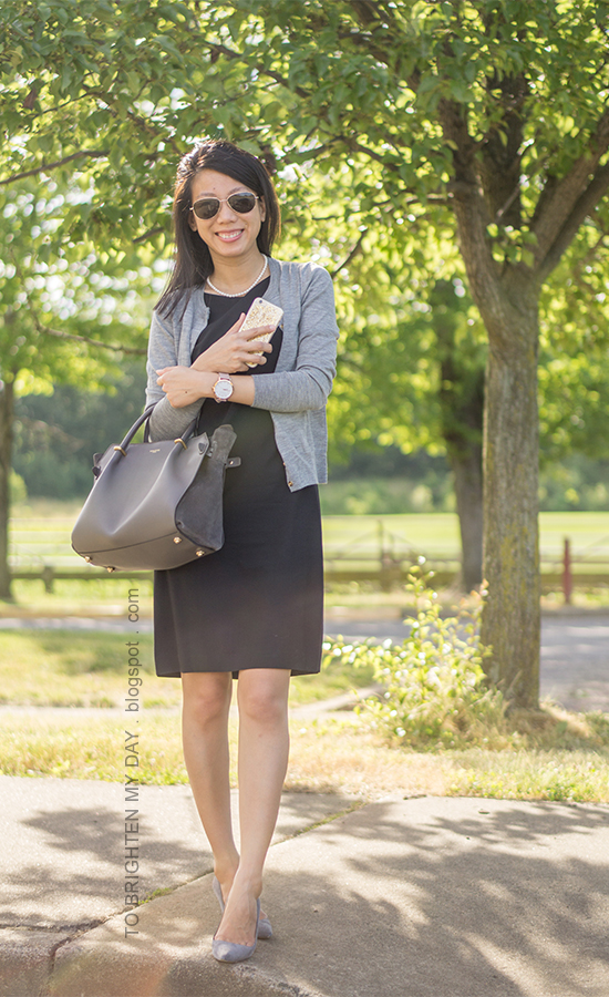 gray cardigan, black sleeveless shift dress, pearl necklace, oversized watch, gray suede heels, gray tote