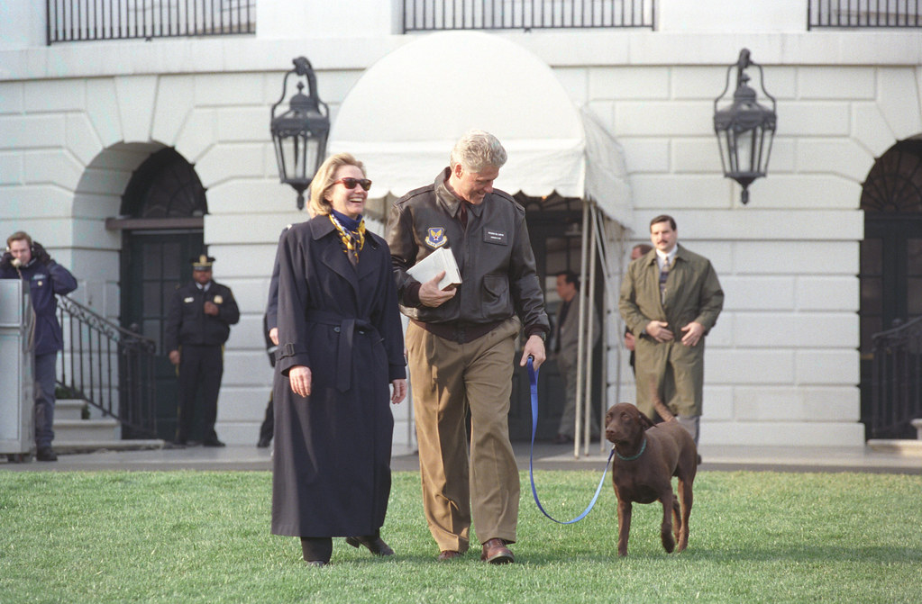 Photograph of President William Jefferson Clinton and First Lady Hillary Rodham Clinton with Buddy the Dog en route to Marine One: 03/13/1998