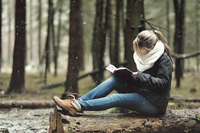 Girl Reading in Snow
