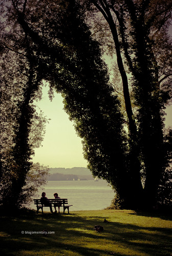 a bench by the lake | by Blogomentary