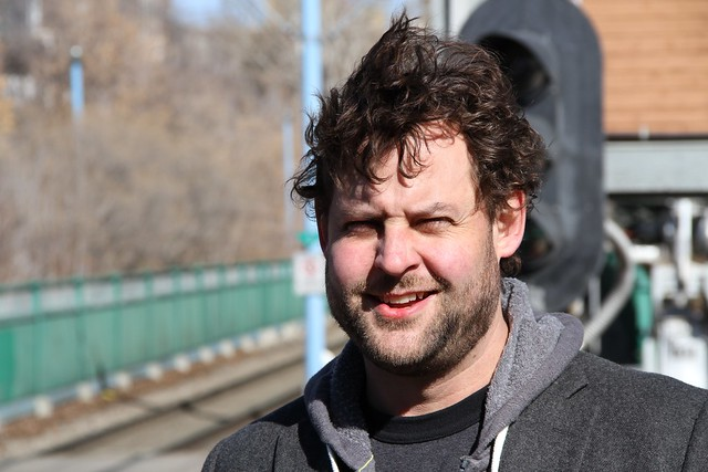 Chris Turner, author of The Leap and Geography of Hope with Calgary's wind-powered LRT - 1