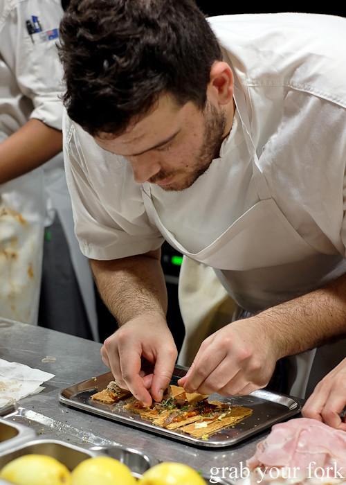 Assembling the Ortiz anchovy tart with roasted bull horn peppers at Mercado restaurant, Sydney