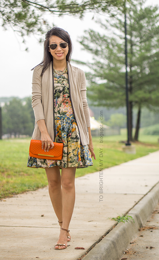 camel piped open cardigan, watercolor floral dress, orange clutch, gold jewelry, jeweled block heeled sandals