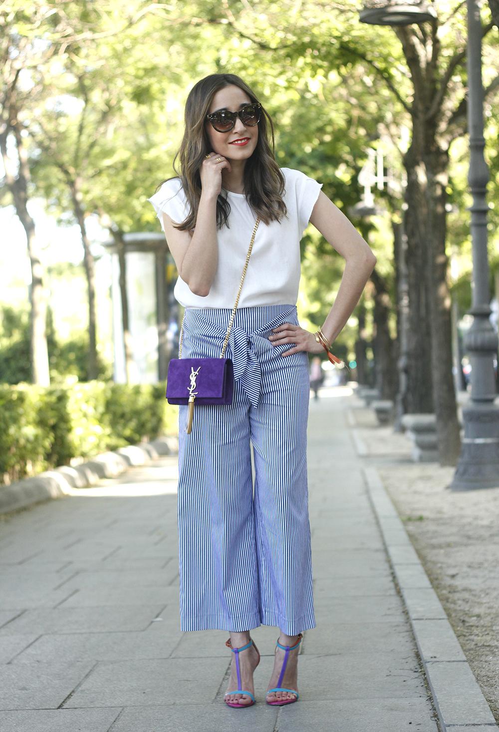 striped pants with bow white shirt carolina herrera sandasl saint laurent bag accessories summer outfit04