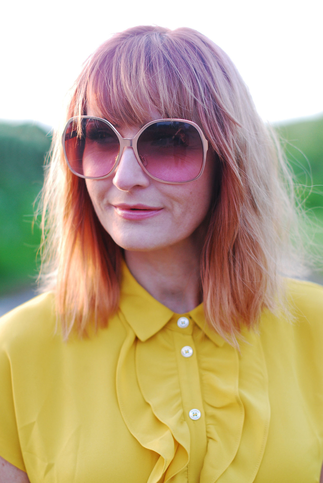 Summer brights: Ruffled yellow blouse, oversized 70s sunglasses | Not Dressed As Lamb