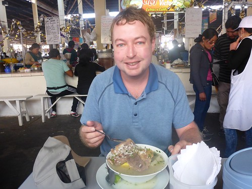 James eating soup at the market