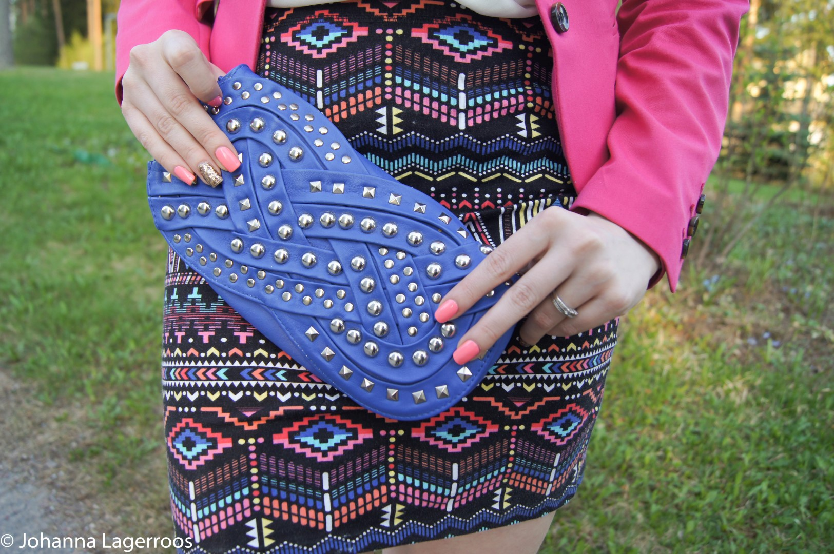 Aztec skirt and blue clutch