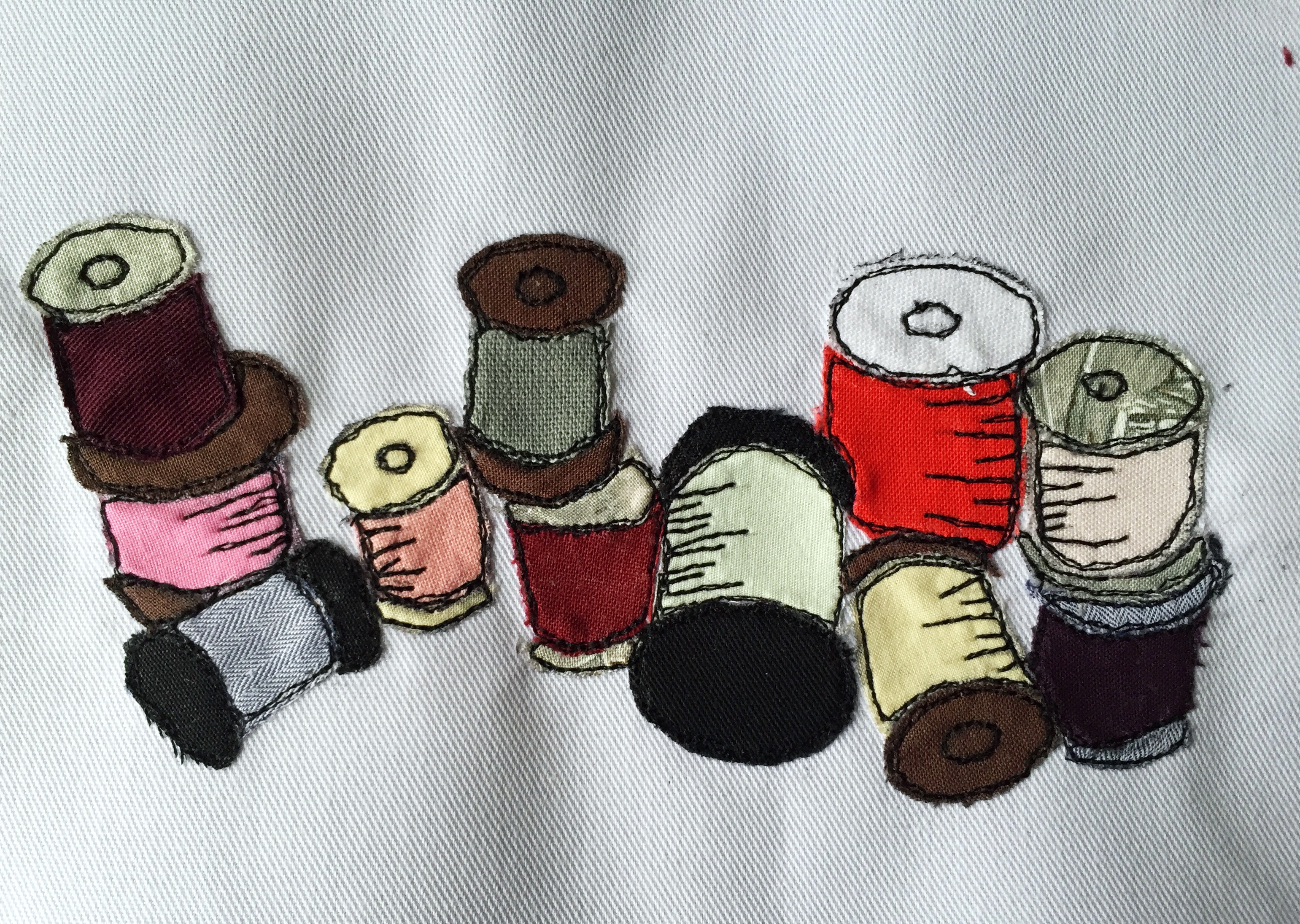 Free motion embroidery thread spools