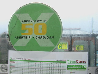 Photo of bus-stop X50 branding with TrawsCymru T5 timetable