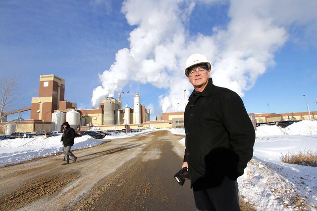 Daryl Nichol VP Pulp in front the ALPAC pulp mill in northern Alberta