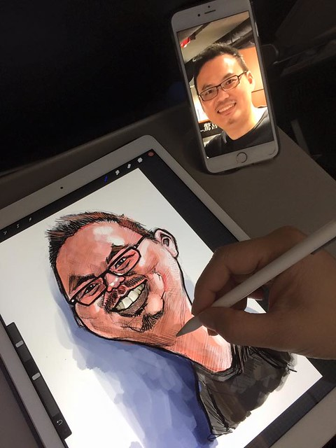 painting Simon Leong on iPad Pro on plane