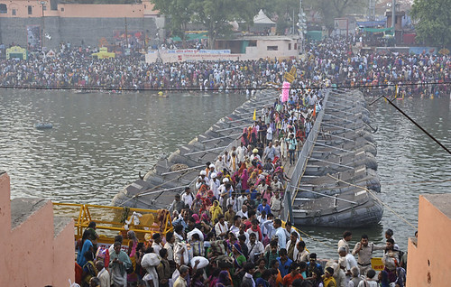 People cross a bridge made by Indian Army from Ramghat to Dutta Akara.
