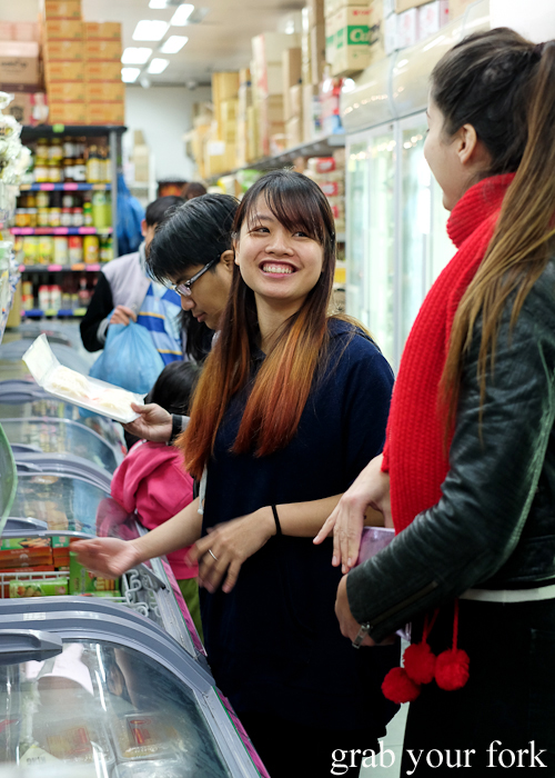 Visiting the Save More Asian grocery store during the Community Kouzina Marrickville Food Tour for Open Marrickville