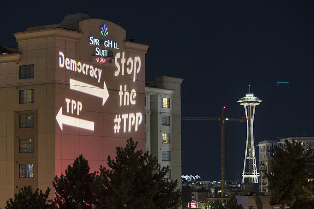 Rock Against the TPP Seattle Guerrilla Light Projection