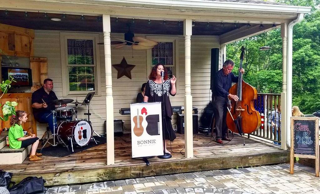 Front porch live graduation party performance.