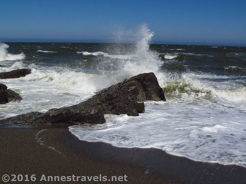 The waves meet the rocks at the southern end of Floras Lake Beach, Oregon