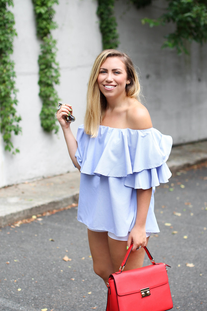 SheIn Blue Ruffle Off The Shoulder Blouse White Shorts Nude Wedge Sandals Galian Red Handbag Easy Casual Summer Outfit Living After Midnite Blogger Jackie Giardina