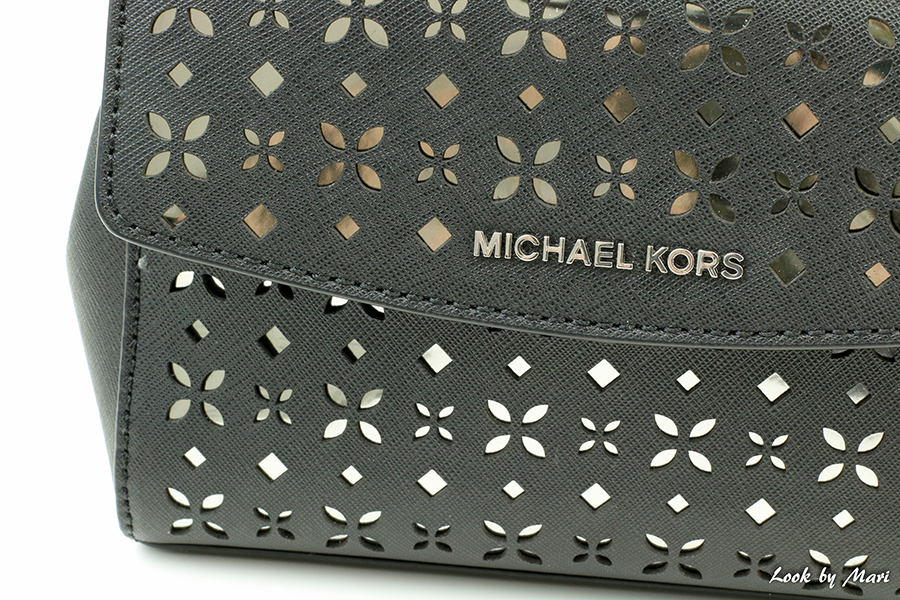 7 Michael Kors Laser-cut black