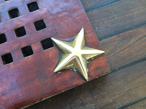 star on wood grating