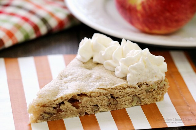 Full of fall flavor and easy to make! This Apple Cider Pecan Cookie Cake with Apple Cider Buttercream Frosting recipe gets off to a quick and easy start with muffin mix! AD