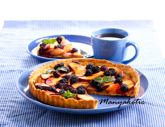 Fruit and berry tart on plate