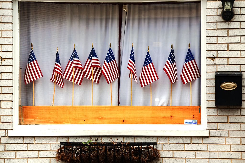 Flags in window on 9-3-16--Passyunk Square