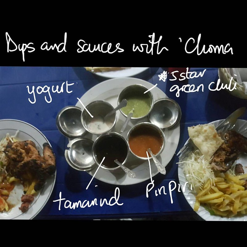 The green chili sauce was my absolute fave - fresh, hot, sweet and perfect for dipping pieces of bread and meat in. #sightsandsoundsofdaressalaam #streetfood #choma #inseason #diningindar #daressalaam #dinnerindar #travelnoire #travelinAfrica