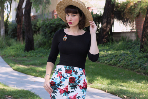 Pinup Girl Clothing Sabrina Top in Black Laura Byrnes High Waisted Cropped Trousers in White and Red Floral Erstwilder Have A Hoot Brooch