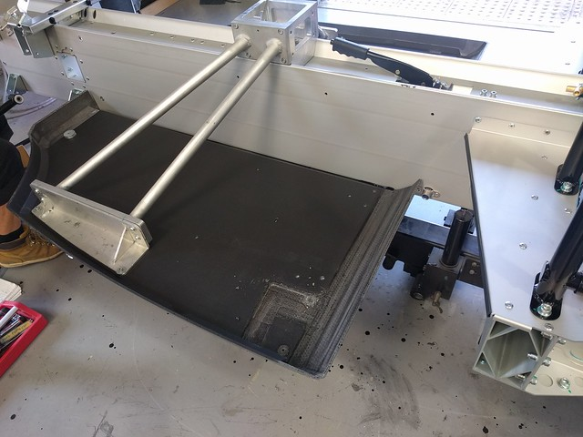 CF Floor pan held in place by a jig for curing