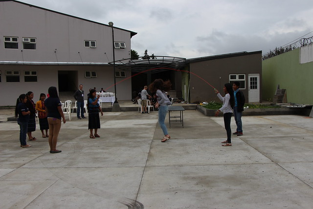 students and tour participants jumping rope together at the new education center