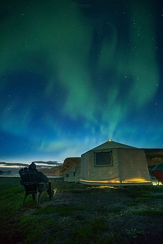 """Aurora Billows"" Sitting back and enjoying the nightly display of northern lights in the Torngat Mountains National Park.That night it seemed to flow straight out of my cabin. :-) Self-portrait, The Torngats. #ExploreTorngats OFFBEAT Newfoundland & Labrad"