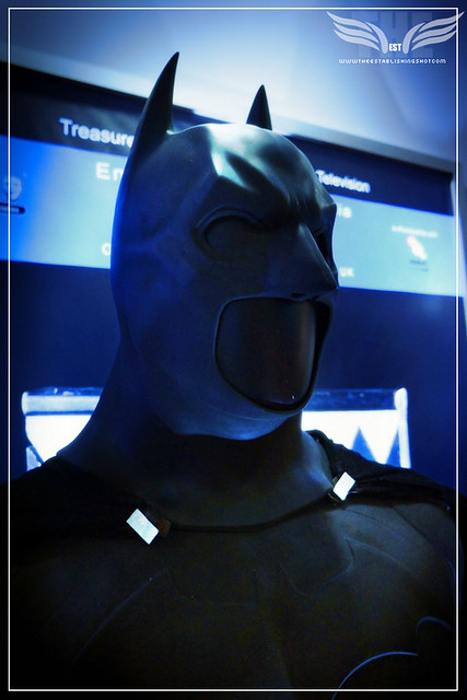 The Establishing Shot: CHRISTIAN BALE'S BATMAN SUIT FROM BATMAN BEGINS, HEAD CLOSE UP - PROP STORE ENTERTAINMENT LIVE AUCTION PREVIEW EXHIBITION - ODEON BFI IMAX, LONDON