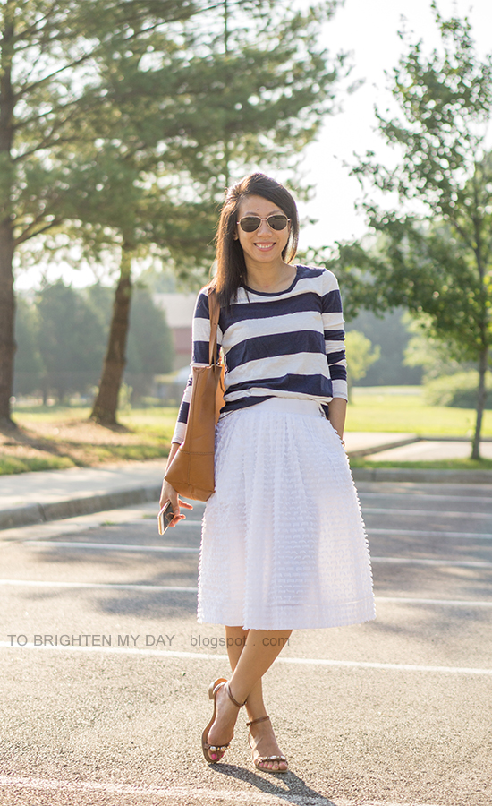 wide navy striped top, white midi skirt with clip dot, cognac brown tote, jeweled block heels