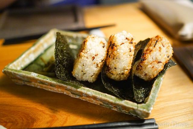 grilled rice omusubi with mushroom, burdock & gourd