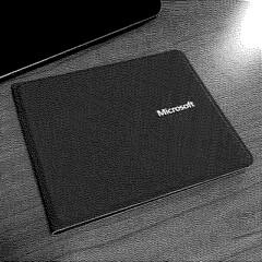 Microsoft Foldable Universal Keyboard: http://marmanold.com/entries/microsoft_universal_keyboard/