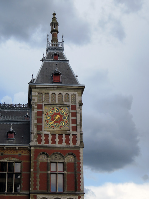 The tower of the Central Station in Amsterdam, Holland has a wind vane
