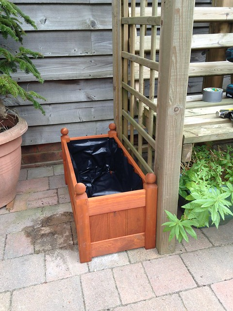 Lined wooden planter