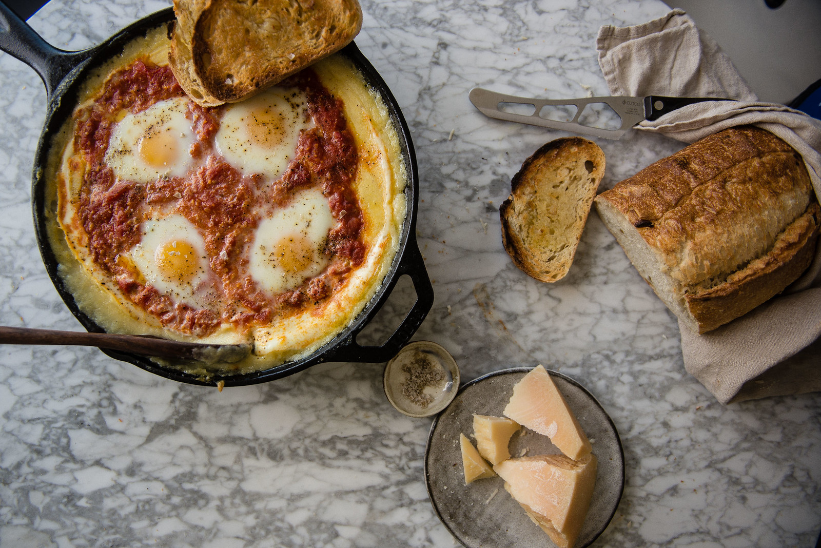 creamy baked polenta with eggs and tomato sauce | two red bowls