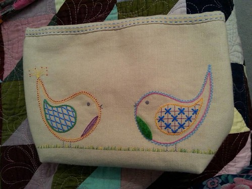 Thanks for all your opinions on whether to add more stitching - in the end I did half a dozen yellow stitches to see how it looked, decided I liked it and carried on. I also added a row of the lighter blue above the yellow. This is another finish for me t