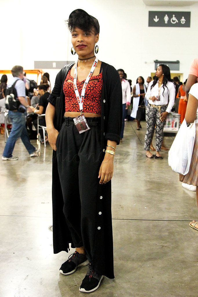 kitenge-african-print-spaghetti-strap-crop-top-with-black-high-waisted-pants-and-trainers