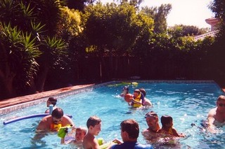 family in the swimming pool in 2000