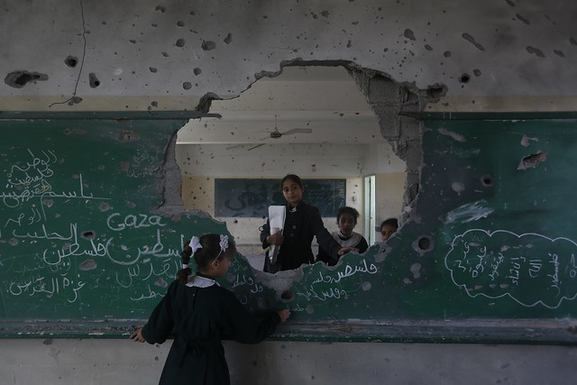 11 year old Manar and her friends at their damaged school in Gaza