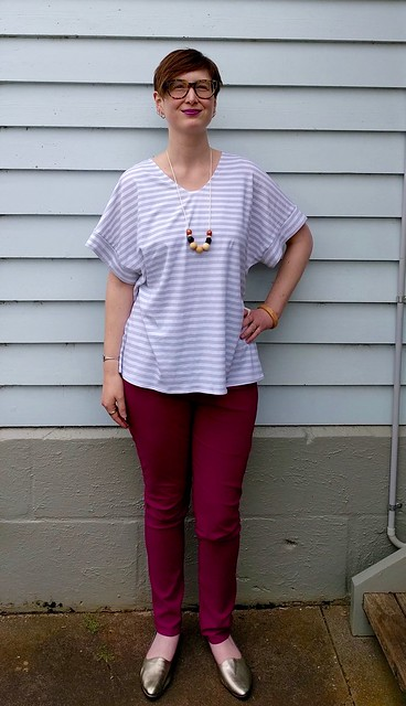 A woman wears Style Arc Elle Pant in berry and Named Sointu Tee in stripes