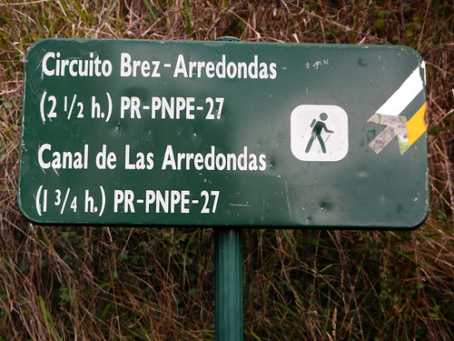 Walks sign in the mountain village of Brez in the Picos de Europa, Spain