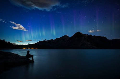 Beautiful night here in Banff last night, with the aurora making an appearance for the first time in several weeks. We even got some noctilucent clouds (above my head in this shot), which we rarely see in the mountains! Self-portrait, Lake Minnewanka, Ban