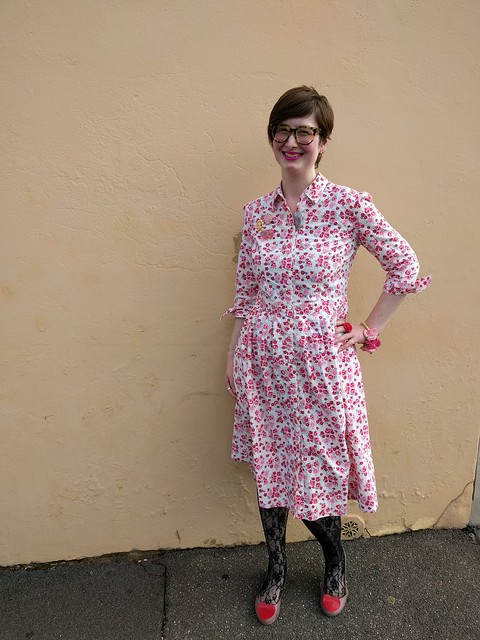 A woman in a floral print shirtdress.