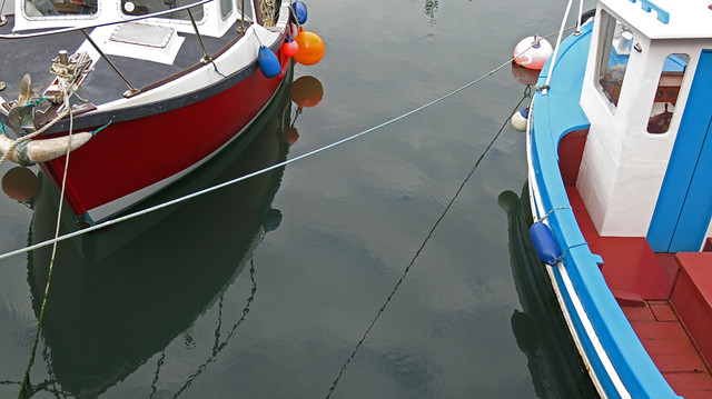 The harbour with boats in Carnlough, a small town on the Coastal Causeway Route of Ireland, UK